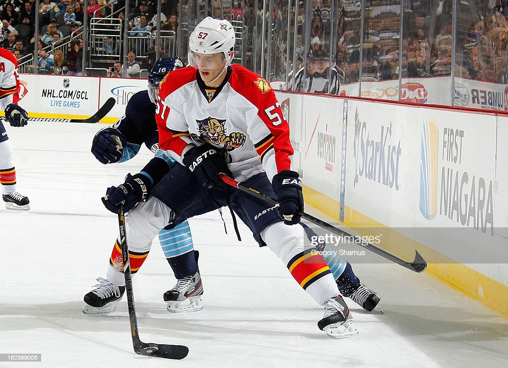Brandon Sutter #16 of the Pittsburgh Penguins reaches for the loose puck while battling for position against Marcel Goc #57 of the Florida Panthers on February 22, 2013 at Consol Energy Center in Pittsburgh, Pennsylvania.