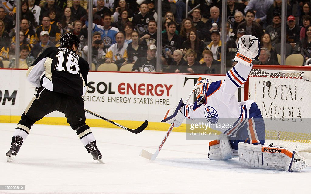 Brandon Sutter #16 of the Pittsburgh Penguins scores past Ben Scrivens #30 of the Edmonton Oilers in the first period during the game at Consol Energy Center on March 12, 2015 in Pittsburgh, Pennsylvania.