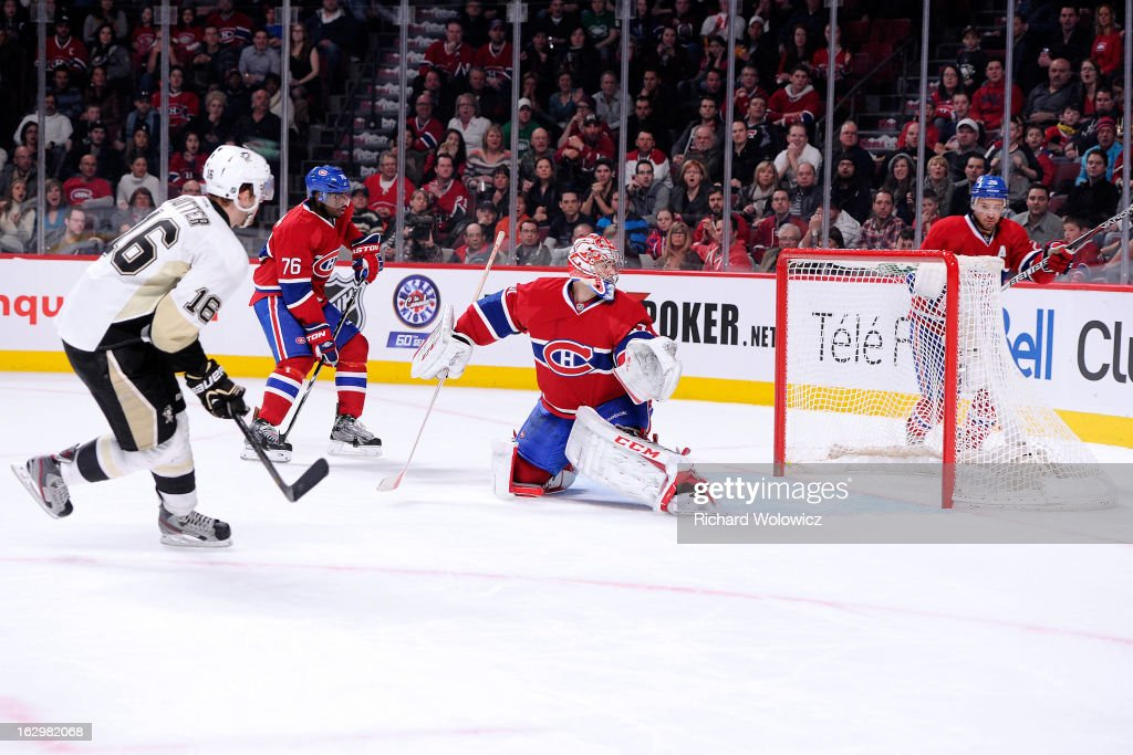 Brandon Sutter of the Pittsburgh Penguins shoots the puck past Carey Price of the Montreal Canadiens to score the gamewinning goal in overtime during...