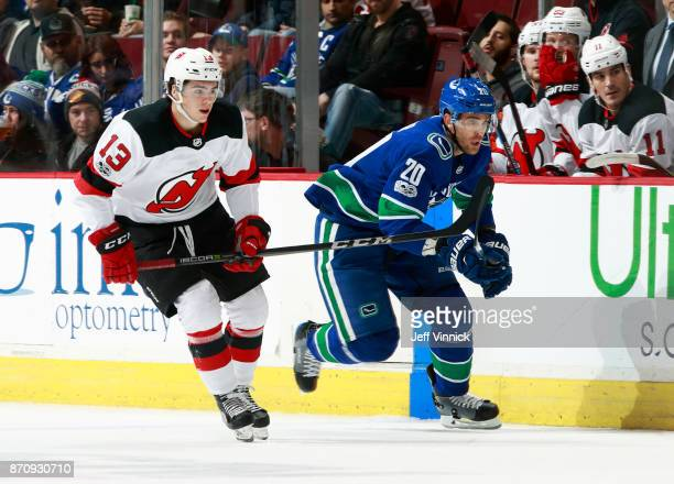 Brandon Sutter of the Vancouver Canucks and Nico Hischier of the New Jersey Devils skate up ice during their NHL game at Rogers Arena November 1 2017...