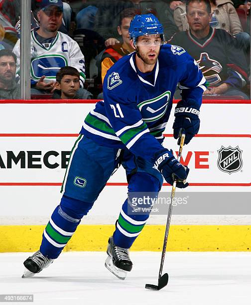 Brandon Sutter of the Vancouver Canucks skates up ice with the puck during their NHL game against the St Louis Blues at Rogers Arena October 16 2015...