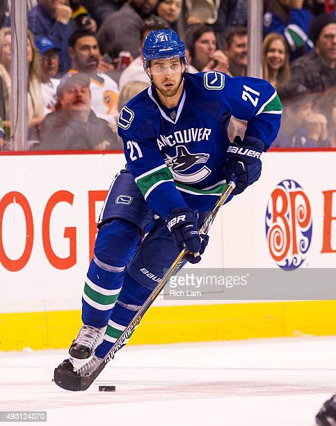 Brandon Sutter of the Vancouver Canucks skates with the puck in NHL action against the Calgary Flames on October 10 2015 at Rogers Arena in Vancouver...