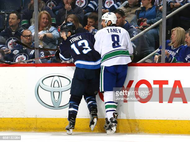 Brandon Tanev of the Winnipeg Jets and Christopher Tanev of the Vancouver Canucks keep an eye on the play during third period action at the MTS...