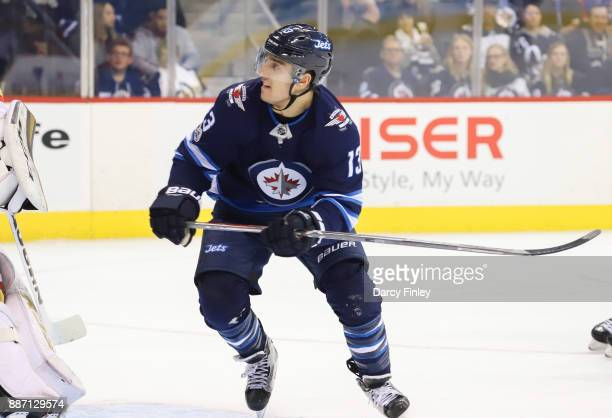 Brandon Tanev of the Winnipeg Jets keeps an eye on the play during first period action against the Vegas Golden Knights at the Bell MTS Place on...