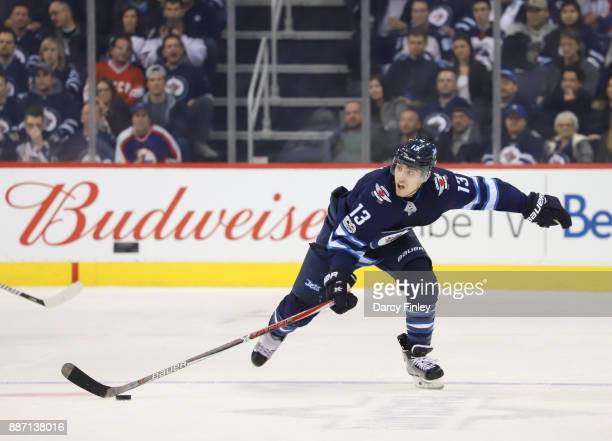 Brandon Tanev of the Winnipeg Jets plays the puck down the ice during third period action against the Vegas Golden Knights at the Bell MTS Place on...