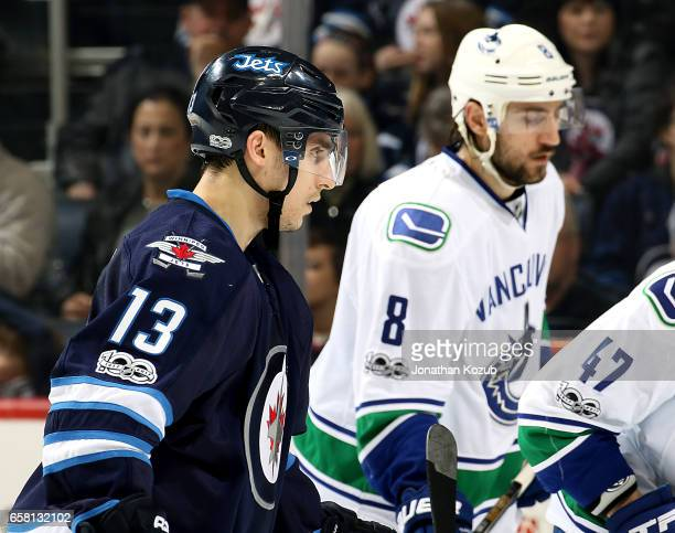 Brandon Tanev of the Winnipeg Jets skates by Christopher Tanev of the Vancouver Canucks as they get set for a third period faceoff at the MTS Centre...
