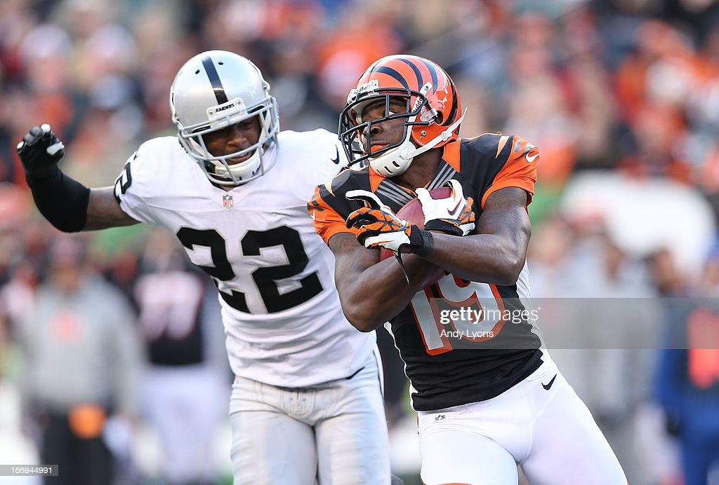 Brandon Tate #19 of the Cincinnati Bengals runs with the ball while defended by Taiwan Jones #22 of the Oakland Raiders during the NFL game at Paul Brown Stadium on November 25, 2012 in Cincinnati, Ohio.