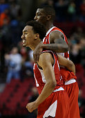 Brandon Taylor and Delon Wright of the Utah Utes celebrate their 75 to 64 win over the Georgetown Hoyas during the third round of the 2015 NCAA Men's...