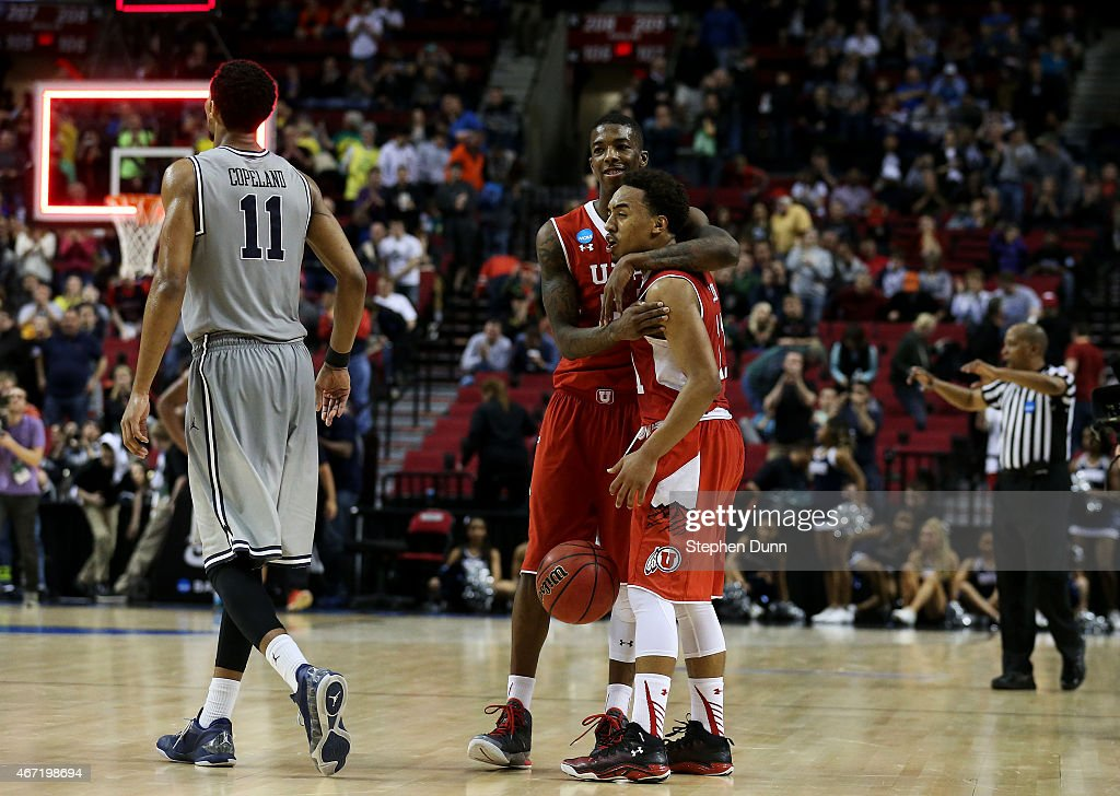 Brandon Taylor #11 and Delon Wright #55 of the Utah Utes celebrate their 75 to 64 win over the Georgetown Hoyas during the third round of the 2015 NCAA Men's Basketball Tournament at Moda Center on March 21, 2015 in Portland, Oregon.