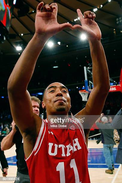 Brandon Taylor of the Utah Utes celebrates after defeating the Duke Blue Devils during the Ameritas Insurance Classic at Madison Square Garden on...