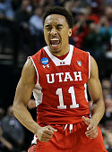 Brandon Taylor of the Utah Utes celebrates in the first half against the Georgetown Hoyas during the third round of the 2015 NCAA Men's Basketball...
