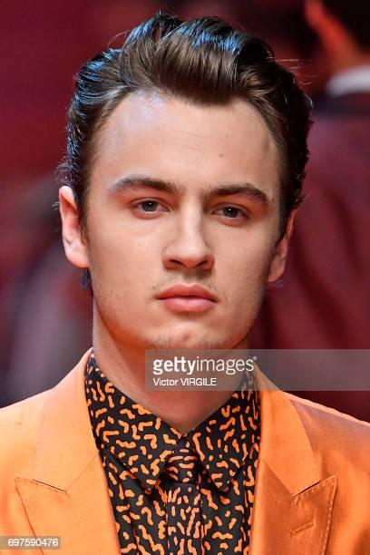 Brandon Thomas Lee walks the runway at the Dolce Gabbana show during Milan Men's Fashion Week Spring/Summer 2018 on June 17 2017 in Milan Italy