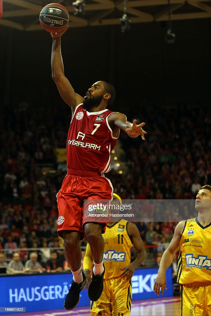 Brandon Thomas of Muenchen shoots against Derrick Byars of Berlin and his team mate Heiko Schaffartzik (R) during Game 3 of the quarterfinals of the Beko Basketball Playoffs between FC Bayern Muenchen and ALBA Berlin at Audi-Dome on May 12, 2013 in Munich, Germany.