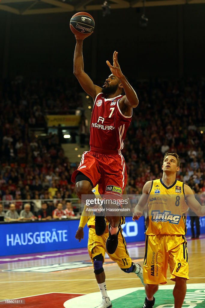 Brandon Thomas of Muenchen shoots against Heiko Schaffartzik of Berlin during Game 3 of the quarterfinals of the Beko Basketball Playoffs between FC Bayern Muenchen and ALBA Berlin at Audi-Dome on May 12, 2013 in Munich, Germany.