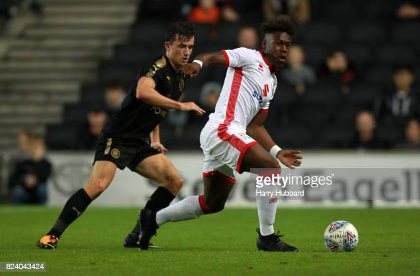 Brandon ThomasAsante of MK Dons and Ben Chilwell of Leicester in action during the preseason friendly match between MK Dons and Leicester City at...