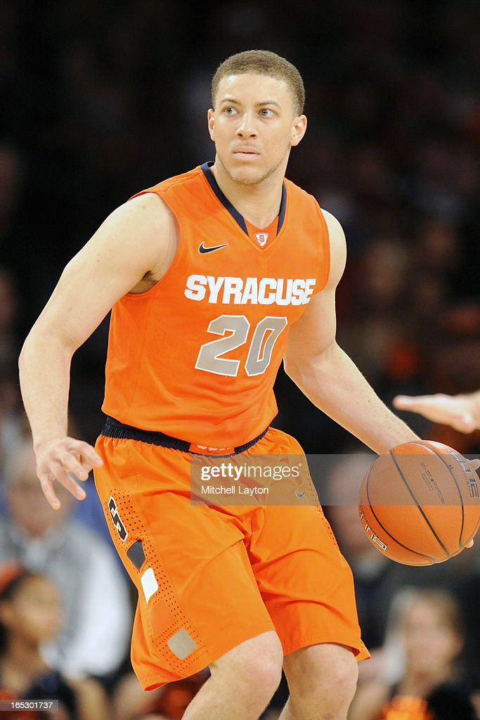 Brandon Triche #20 of the Syracuse Orange dribbles upcourt during the finals of the Big East Basketball Tournament against the Louisville Cardinals at Madison Square Garden on March 16, 2013 in New York City. The Cardinals won 78-61.