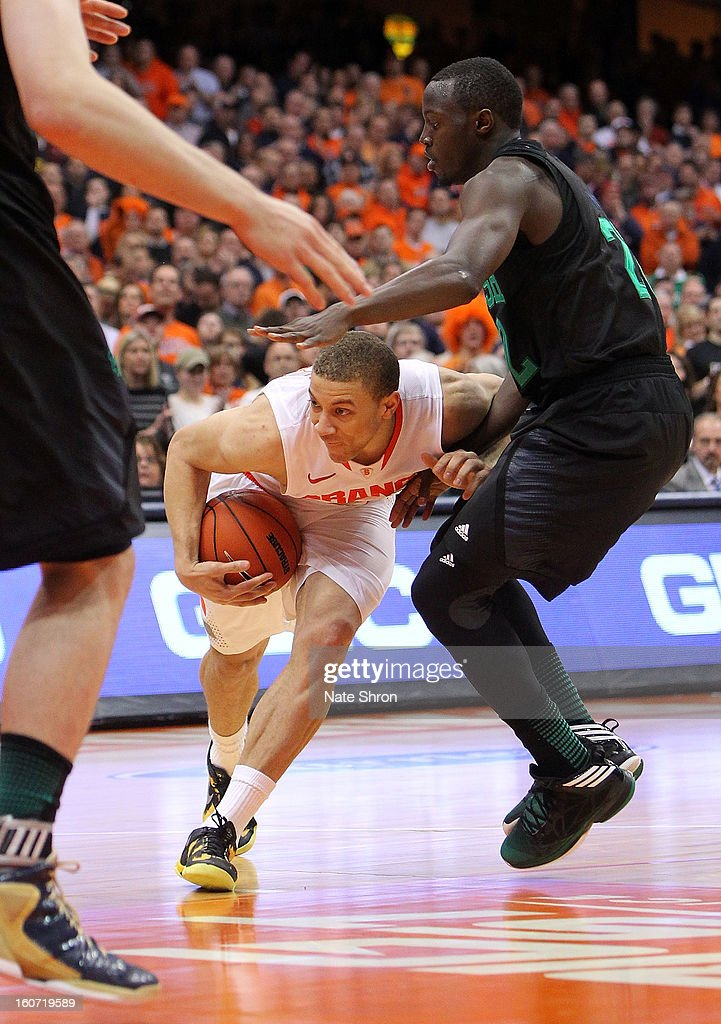 Brandon Triche #20 of the Syracuse Orange drives to the basket against Jerian Grant #22 of the Notre Dame Fighting Irish during the game at the Carrier Dome on February 4, 2013 in Syracuse, New York.
