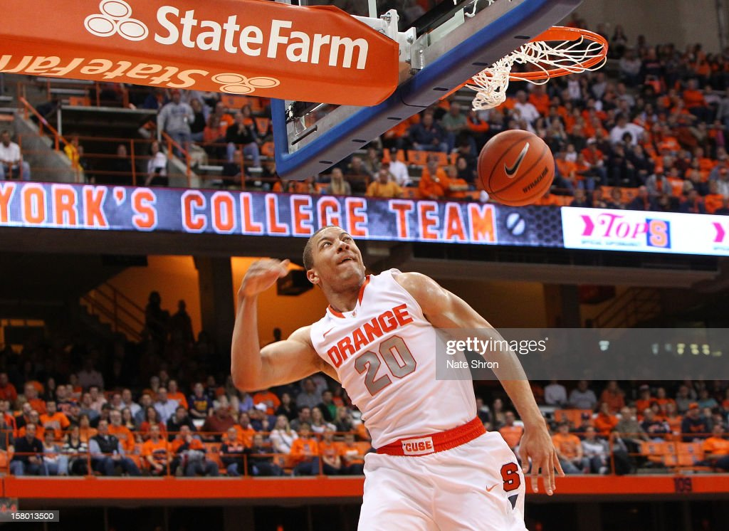 <a gi-track='captionPersonalityLinkClicked' href=/galleries/search?phrase=Brandon+Triche&family=editorial&specificpeople=6516120 ng-click='$event.stopPropagation()'>Brandon Triche</a> #20 of the Syracuse Orange dunks the ball during the game against the Monmouth Hawks at the Carrier Dome on December 8, 2012 in Syracuse, New York.