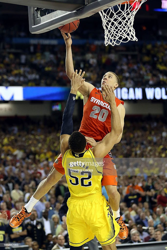 Brandon Triche #20 of the Syracuse Orange is called for a charging foul in the final minute of the second half against Jordan Morgan #52 of the Michigan Wolverines during the 2013 NCAA Men's Final Four Semifinal at the Georgia Dome on April 6, 2013 in Atlanta, Georgia.