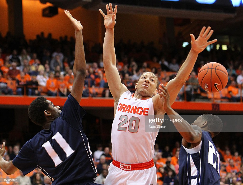 <a gi-track='captionPersonalityLinkClicked' href=/galleries/search?phrase=Brandon+Triche&family=editorial&specificpeople=6516120 ng-click='$event.stopPropagation()'>Brandon Triche</a> #20 of the Syracuse Orange loses the ball against Khalil Brown #11 and Marcus Ware #21 of the Monmouth Hawks during the game at the Carrier Dome on December 8, 2012 in Syracuse, New York.