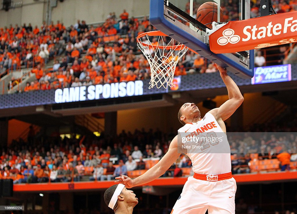 Brandon Triche #20 of the Syracuse Orange puts the ball up to the basket against Latif Rivers #24 of the Wagner Seahawks during the game at the Carrier Dome on November 18, 2012 in Syracuse, New York.