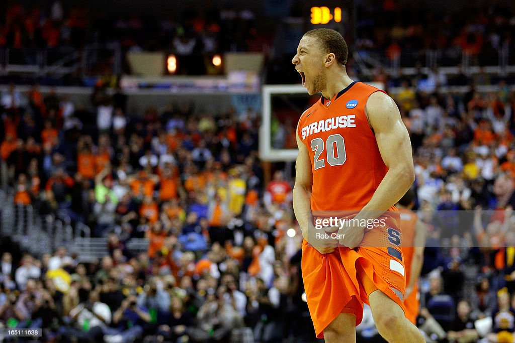 <a gi-track='captionPersonalityLinkClicked' href=/galleries/search?phrase=Brandon+Triche&family=editorial&specificpeople=6516120 ng-click='$event.stopPropagation()'>Brandon Triche</a> #20 of the Syracuse Orange reacts towards the end of the game against the Marquette Golden Eagles during the East Regional Round Final of the 2013 NCAA Men's Basketball Tournament at Verizon Center on March 30, 2013 in Washington, DC.