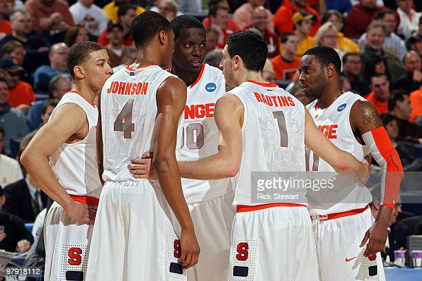 Brandon Triche Wes Johnson Rick Jackson Andy Rautins and Scoop Jardine of the Syracuse Orange huddle up on the court against the Gonzaga Bulldogs...