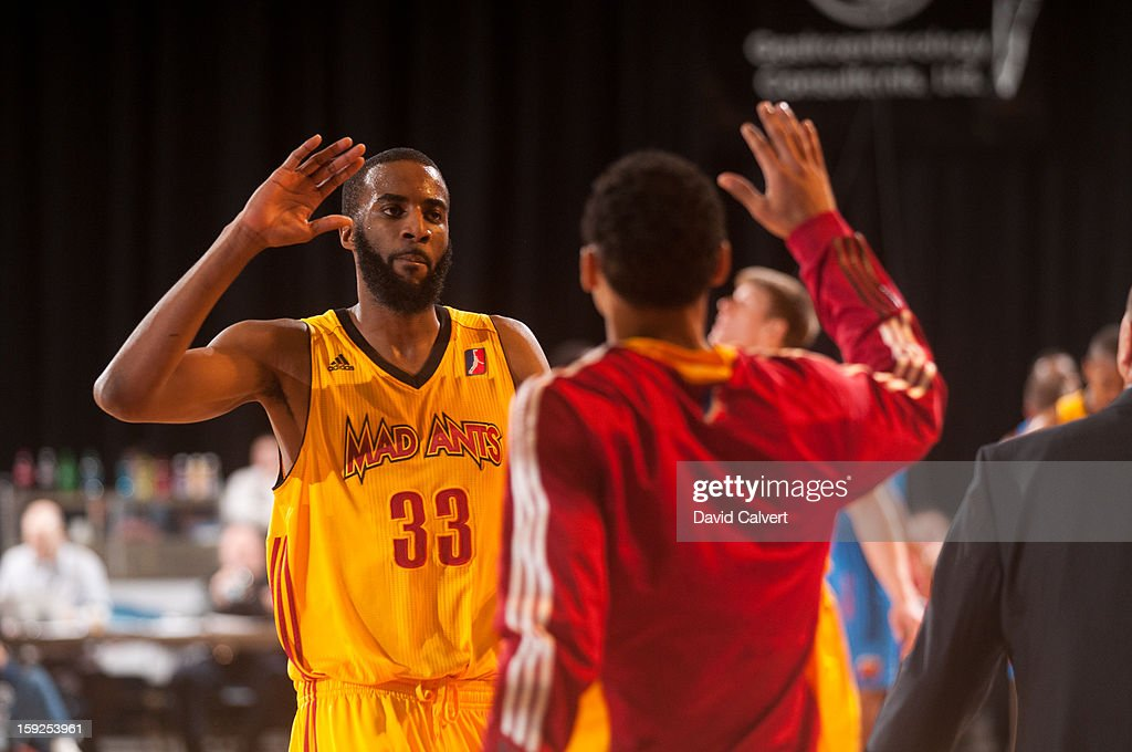 <a gi-track='captionPersonalityLinkClicked' href=/galleries/search?phrase=Brandon+Wallace&family=editorial&specificpeople=712566 ng-click='$event.stopPropagation()'>Brandon Wallace</a> #33 of the Fort Wayne Mad Ants high fives a teammate during a timeout against Tulsa 66ers during the 2013 NBA D-League Showcase on January 10, 2013 at the Reno Events Center in Reno, Nevada.