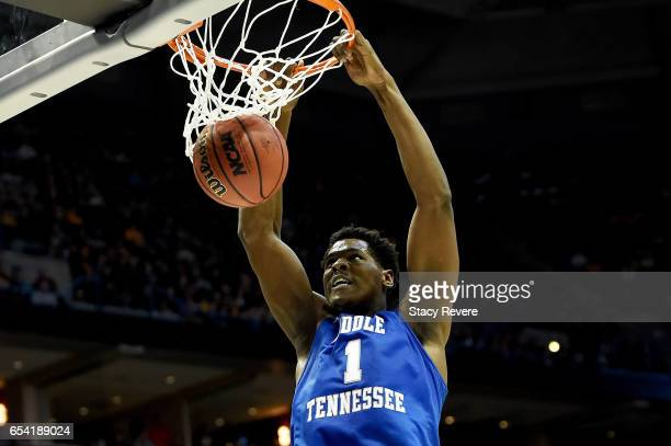 Brandon Walters of the Middle Tennessee Blue Raiders dunks in the first half against the Minnesota Golden Gophers during the first round of the 2017...