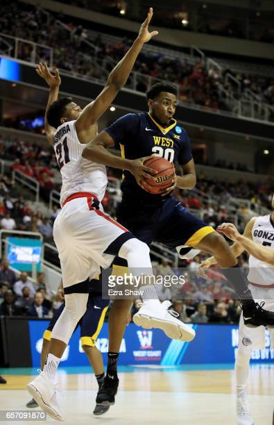 Brandon Watkins of the West Virginia Mountaineers attempts a shot defended by Rui Hachimura of the Gonzaga Bulldogs during the 2017 NCAA Men's...