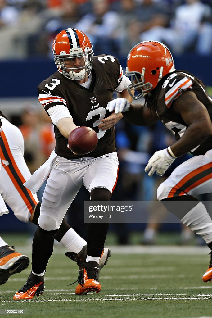 <a gi-track='captionPersonalityLinkClicked' href=/galleries/search?phrase=Brandon+Weeden&family=editorial&specificpeople=7125737 ng-click='$event.stopPropagation()'>Brandon Weeden</a> #3 makes a handoff to <a gi-track='captionPersonalityLinkClicked' href=/galleries/search?phrase=Trent+Richardson&family=editorial&specificpeople=5653463 ng-click='$event.stopPropagation()'>Trent Richardson</a> #33 of the Cleveland Browns during a game against the Dallas Cowboys at Cowboys Stadium on November 18, 2012 in Arlington, Texas. The Cowboys defeated the Browns 23-20.