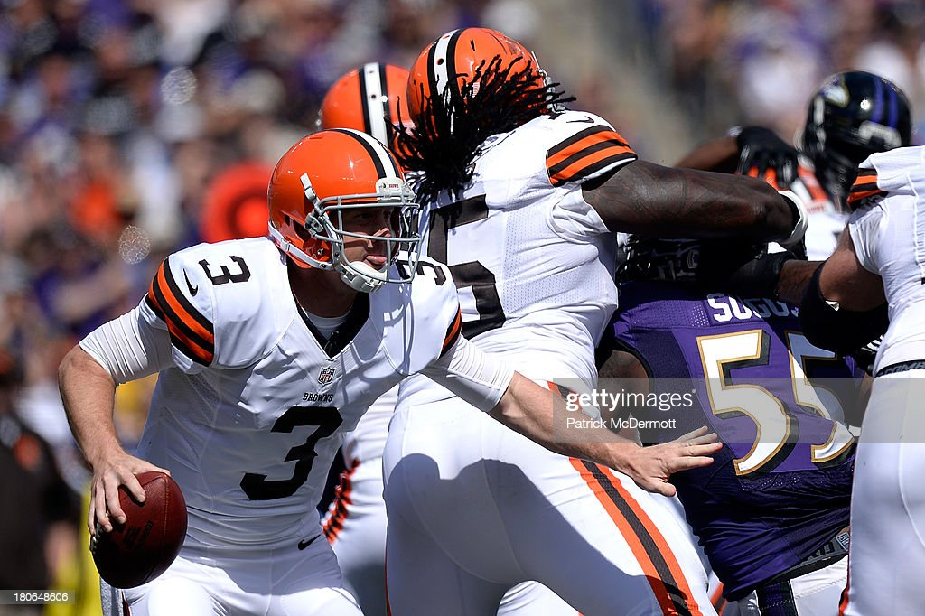 Brandon Weeden #3 of the Cleveland Browns scrambles with the ball during the first half of a game against the Baltimore Ravens at M&T Bank Stadium on September 15, 2013 in Baltimore, Maryland.