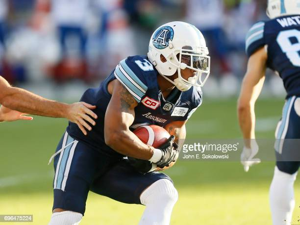 Brandon Whitaker#3 of the Toronto Argonauts takes a handoff against the Montreal Alouettes during a CFL preseason game at BMO field on June 8 2017 in...
