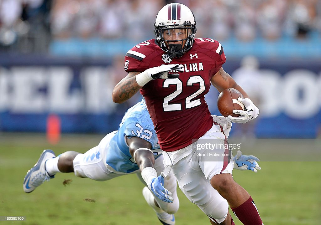 Brandon Wilds of the South Carolina Gamecocks breaks away from Joe Jackson of the North Carolina Tar Heels during their game at Bank of America...