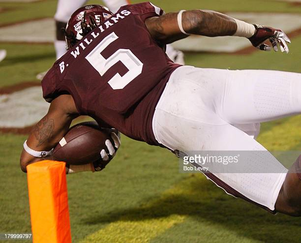 Brandon Williams of the Texas AM Aggies scores on a ten yard run in the third quarter against the Sam Houston State Bearkats at Kyle Field on...