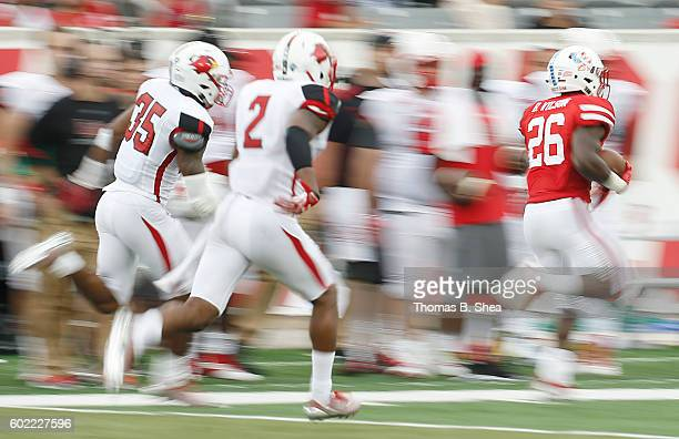 Brandon Wilson of the Houston Cougars returns a punt against the Lamar Cardinals in the second quarter at TDECU Stadium on September 10 2016 in...