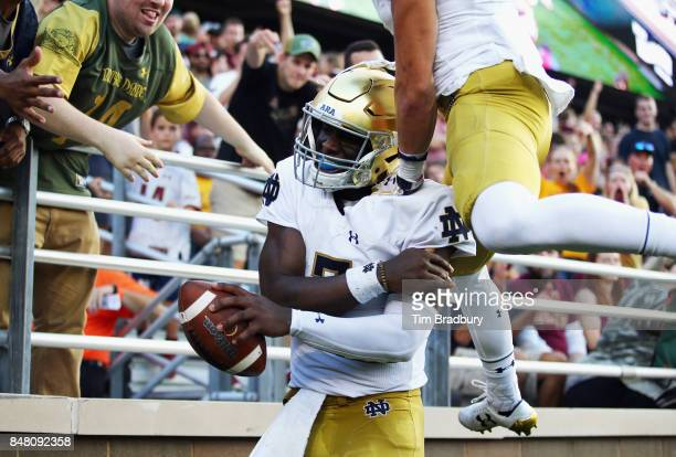 Brandon Wimbush of the Notre Dame Fighting Irish celebrates after rushing for a 65yard touchdown during the fourth quarter against the Boston College...