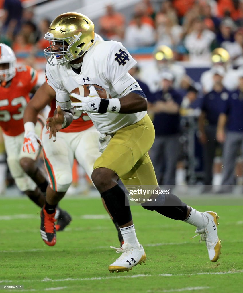 Brandon Wimbush #7 of the Notre Dame Fighting Irish rushes during a game against the Miami Hurricanes at Hard Rock Stadium on November 11, 2017 in Miami Gardens, Florida.