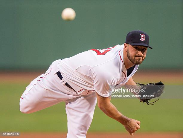 Brandon Workman of the Boston Red Sox pitches against the Chicago Cubs in the first inning at Fenway Park on July 2 2014 in Boston Massachusetts...