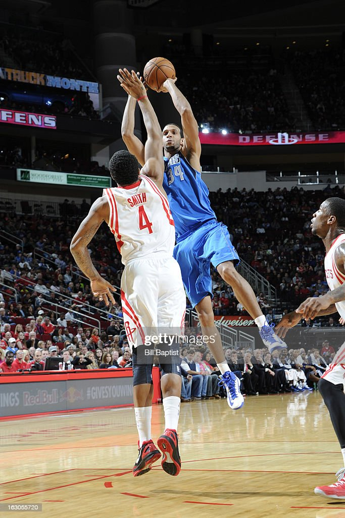 Brandon Wright #34 of the Dallas Mavericks shoots the ball against Greg Smith #4 of the Houston Rockets on March 3, 2013 at the Toyota Center in Houston, Texas.
