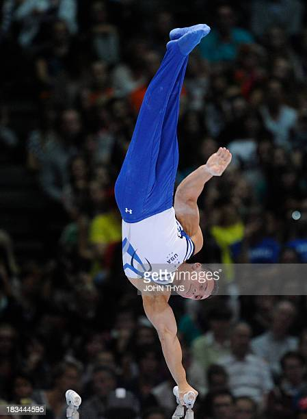 Brandon Wynn of the US performs on the parallel bars at the 44th Artistic Gymnastics World Championships in Antwerp on October 6 2013 AFP PHOTO /...