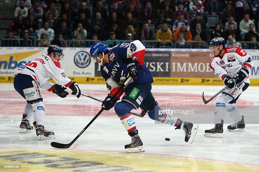 Brandon Yip 8c9 of Mannheim is challenged by Petr Pohl of Berlin during the DEL match between Adler Mannheim and Eisbaeren Berlin at SAP Arena on...