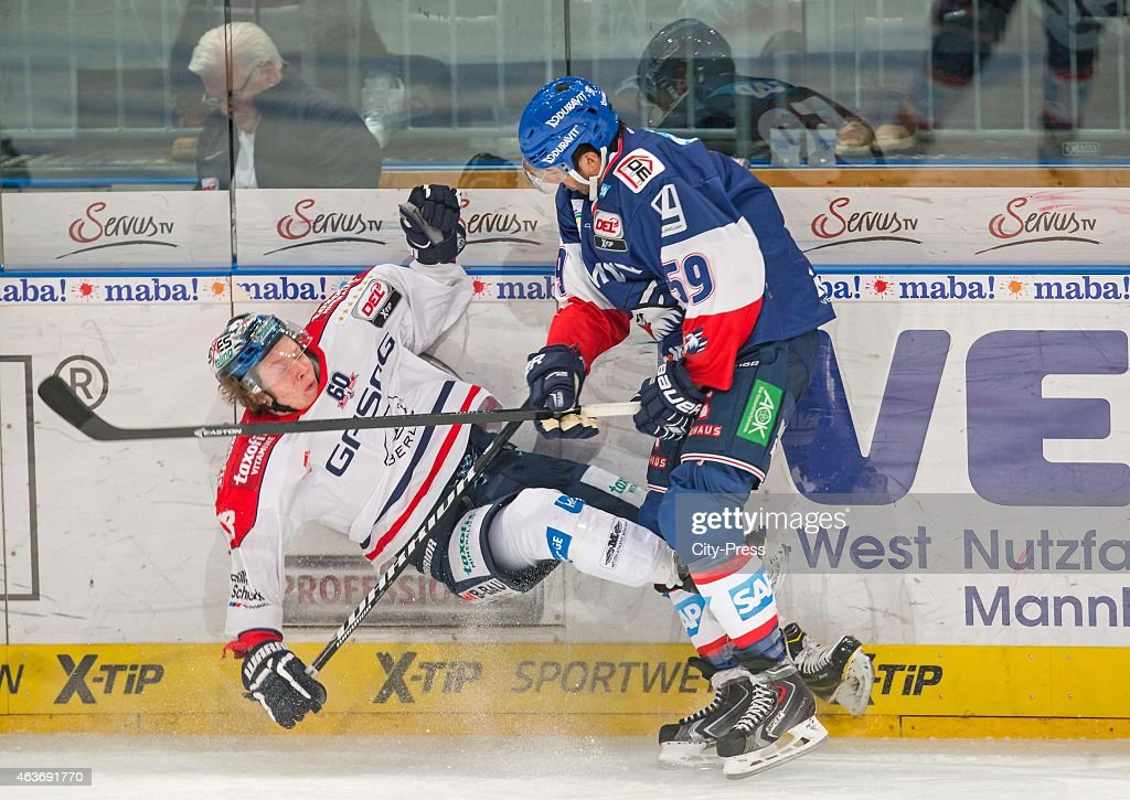 Brandon Yip of Adler Mannheim gives a Bodycheck to Jonas Mueller of Eisbaeren Berlin during the game between Adler Mannheim and Eisbaeren Berlin on...