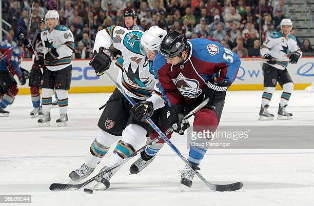 Brandon Yip of the Colorado Avalanche and MarcEdouard Vlasic of the San Jose Sharks battle to control the puck in Game Three of the Western...