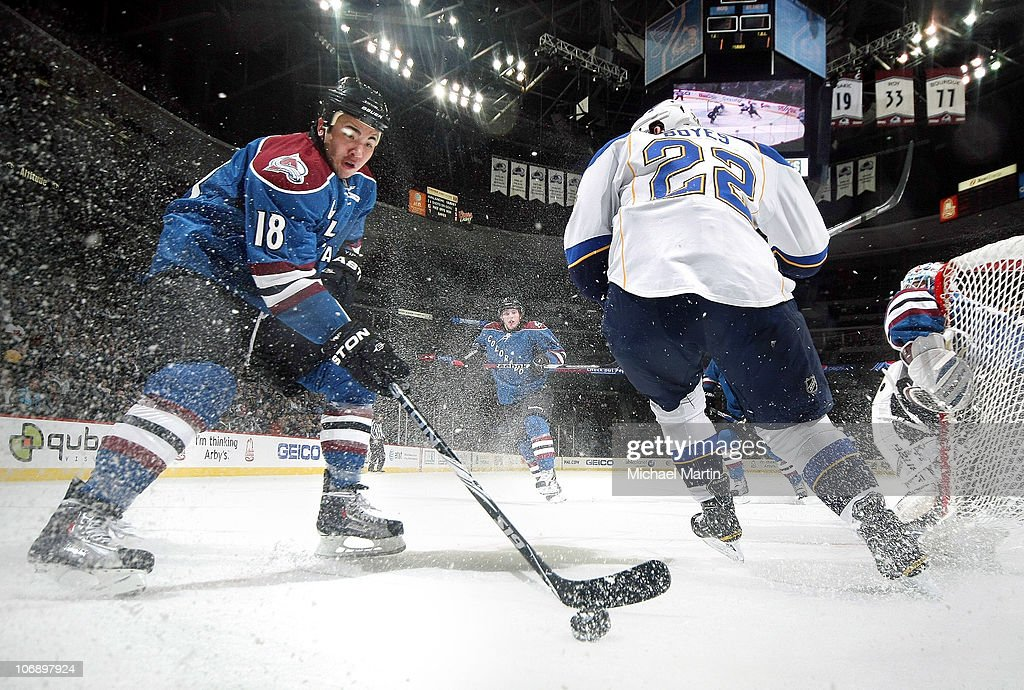 Brandon Yip of the Colorado Avalanche takes the puck away from Brad Boyles the St Louis Blues at the Pepsi Center on November 15 2010 in Denver...