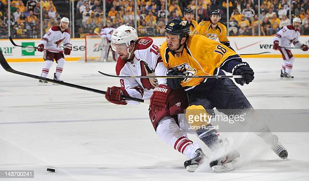 Brandon Yip of the Nashville Predators battles against Shane Doan of the Phoenix Coyotes in Game Three of the Western Conference Semifinals during...