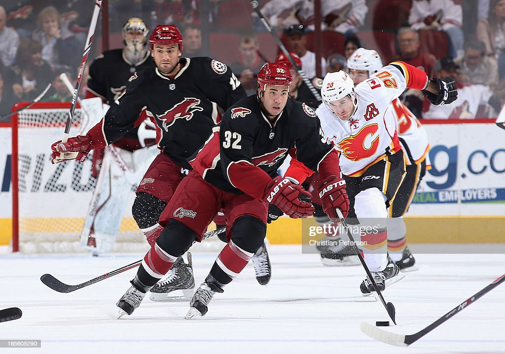 Brandon Yip of the Phoenix Coyotes skates up ice with the puck during the first period of the NHL game against the Calgary Flames at Jobingcom Arena...