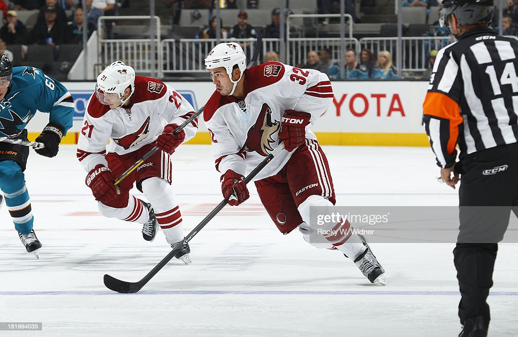 Brandon Yip of the Phoenix Coyotes skates with control of the puck against the San Jose Sharks during a preseason NHL game at SAP Center on September...
