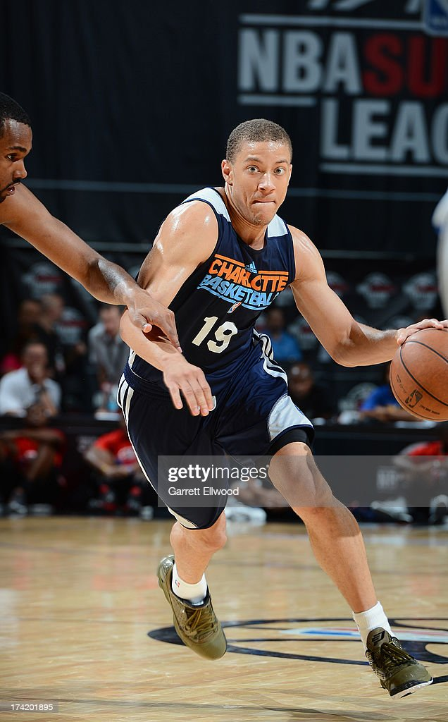 Brandon Triche #19 of the Charlotte Bobcats drives under pressure during NBA Summer League game between the Charlotte Bobcats and the Golden State Warriors on July 21, 2013 at the Cox Pavilion in Las Vegas, Nevada.