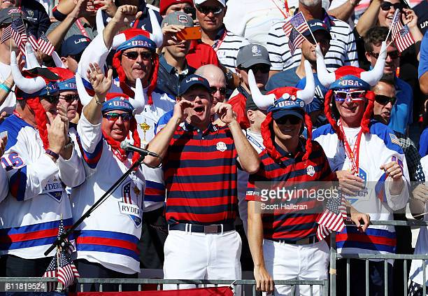 Brandt Snedeker and Zach Johnson of the United States celebrate with fans in the crowd during afternoon fourball matches of the 2016 Ryder Cup at...